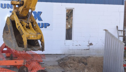 A city backhoe hit the United Tax Group building on Centre Street last week, damaging the business's front wall.