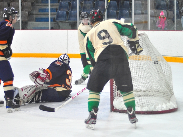 Second-year player Ashton McIntyre (facing) bangs home the winning goal against the St. Walburg Eagles in overtime Saturday night while linemate Jordan Iron (9) looks on. It was the Stamps' first win over the league-leading Eagles in three attempts this season.