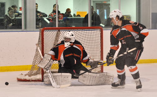 Meadow Lake netminder Jared Lafond turns aside a shot in the final game while defenceman Drew Rose looks on.