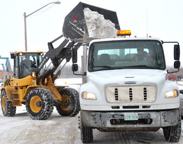 City workers clear snow from 3rd Street West Wednesday afternoon. Meadow Lake's public works department would like to see more reliable equipment made available to perform day-to-day operations.