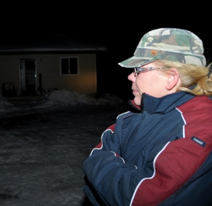 Shelly Hammell takes a long look at the house she was renting on the Matchee-Neeb Road. Hammell lost most of her belongings when a fire broke out at the home Feb. 19.