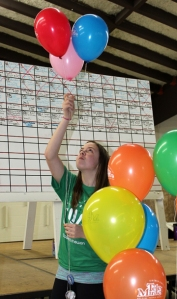 Volunteer Ashley Esterby arranges balloons as part of Telemiracle 37 festivities at the Meadow Lake Civic Centre March 3.