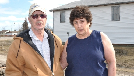 Virgil and Fran Paul stand outside their home in Makwa, days after high spring run-off flooded their property, as well as the lower floor of their house. The couple would like to see the province address the concerns they have with the ability of nearby culverts to handle water flow.