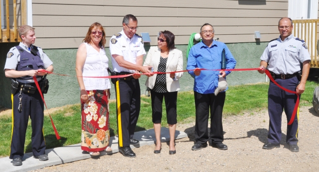 The Meadow Lake RCMP held a ribbon-cutting ceremony July 4 for the new police residences at Waterhen Lake First Nation. Pictured, left to right, are RCMP Cst. Cam Saint-Martin, Waterhen band councillor Joanne Roy, RCMP Assistant Commissioner Russ Mirasty, Waterhen chief Carol Bernard, band councillor Martin Larocque and RCMP Staff Sgt. Tim Korman.