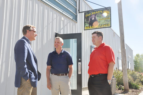 Saskatchewan Premier Brad Wall (left) chats with Meadow Lake mayor Gary Vidal (centre) and Meadow Lake MLA Jeremy Harrison outside the Bear's Den on 1st Street East Sept. 12. Wall was in Meadow Lake as part of a summer tour to various Saskatchewan communities.