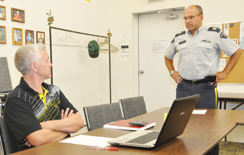 Meadow Lake mayor Gary Vidal (left) chats with RCMP Staff Sgt. Tim Korman prior to a special meeting on crime reduction initiatives held at the Lions Den Aug. 29.