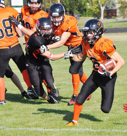Grade 12 student and CHS Spartans player Braiden Dull relies on his teammates to keep Delisle Rebels players at bay during Meadow Lake's home-opener Sept. 13.