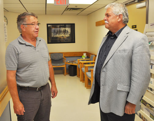 Dr. Leon Bekker (left) of the Loon Lake Health Centre and Special Care Home chats with Randy Weekes, provincial minister responsible for rural and remote health, during Weekes' visit to the facility Sept. 3.