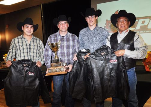 The CPCA 2013 Canadian Champion and Outriders award was presented to the winning driver and outriders of this season's CPCA Finals Dash. Along with a trophy, the group also received leather championship jackets. Here, left to right, outrider Dale Mitsuing, driver Vern Nolin and outrider Brett Nolin receive their jackets from CPCA president Ray Mitsuing.