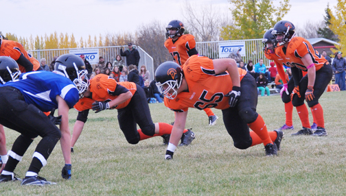 Spartans players, including Pete Martell (65), prepare to go on the defensive during Meadow Lake's 73-13 win against Martensville.