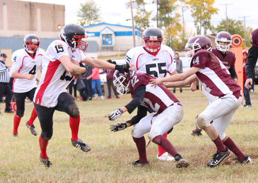 Football in northern Saskatchewan is underway and last Wednesday the Buffalo Narrows Eagles paid a visit to Beauval to take on the Voyageurs. Here, Aaron Thompson (15) of the Buffalo Narrows Eagles attempts to get by two Beauval players.