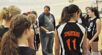 CHS girls volleyball coach Dion Petz addresses the team between sets Oct. 18.