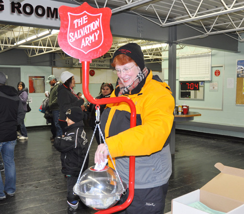 Lee Schenk of Meadow Lake provides a donation to the Salvation Army's annual Kettle Campaign during Friday's Battle of the Badges hockey game at the Meadow Lake Arena. With Christmas just around the corner, various fundraising initiatives have recently kicked into high gear. This year's Battle of the Badges raised close to $6,400. For more photos, see page 18.