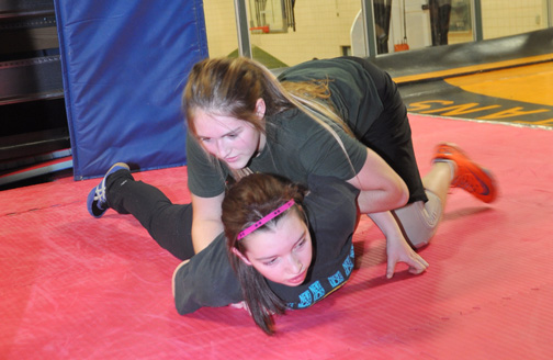 Carpenter High School wrestler Carah Oftedal (top) applies a hold to fellow wrestler Marlie Bundschuh during a practice session held at the school last week. The first high school wrestling tournament of the season is scheduled for December.