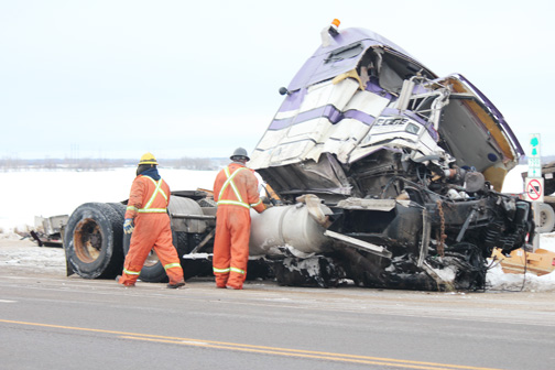 A cleanup crew on the scene the day after a recent crash involving two semi tractor trailers south of Meadow Lake.