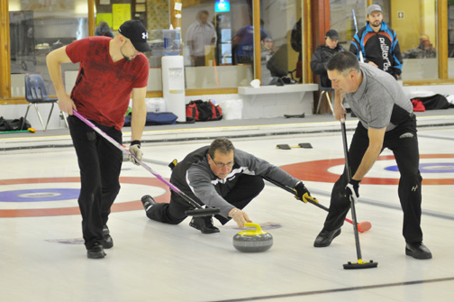 From Jan. 18-20, the Meadow Lake Curling Club hosted the 2014 Sasktel Men's Northern Curling Championship. Sixteen teams from across CurlSask's northern division competed for five spots in the upcoming provincial tournament. Here, Meadow Lake skip Vince Huffman releases a rock while lead Terry Pylot and second Greg Kuffert prepare to sweep.