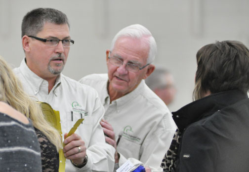 Ducks Unlimited members Darcy Thomas (left) and Dan Schmid were among the many volunteers selling 50/50 tickets during last Thursday's fundraiser.
