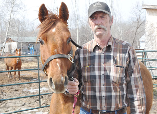 Russel Klassen, seen here with one of several horses he keeps on his property, was recently given 30 days to remove them or be faced with a $250 fine for violating an RM of Meadow Lake bylaw he said has never been enforced in the more than 15 years since it was introduced.