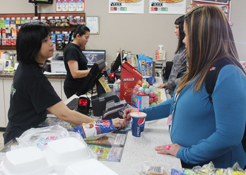 Originally from the Philippines, Irene Ocampo works the cash register at City Convenience in Meadow Lake.