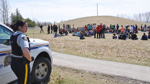 RCMP Cst. Lesley Somers was one of several officers who kept watch as students converged on Lions Park in Meadow Lake after being evacuated from their schools Friday afternoon. Carpenter High School and Lakeview Elementary, however, remained on lockdown while police secured the buildings and schoolyards. Classes resumed Tuesday.