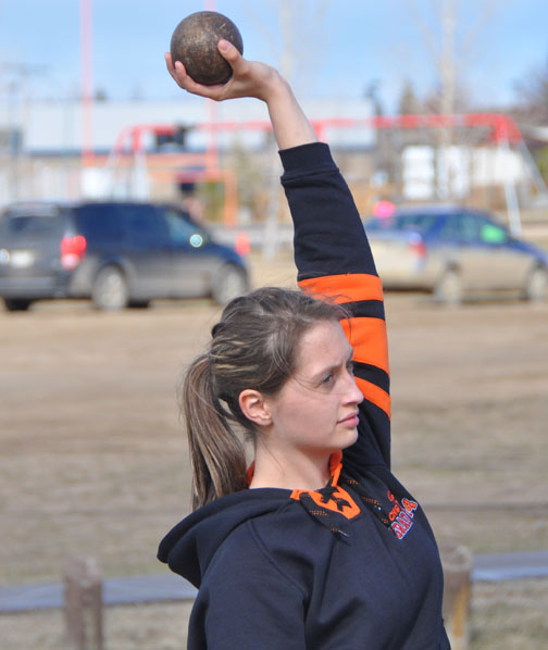 Track and field season is underway at schools throughout the Northwest including Carpenter High School and Jonas Samson Junior High in Meadow Lake. Here, CHS student Sabrinna McNabb shows off her shot-put technique during a practice session May 1.