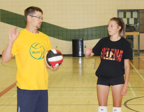 Young people from Meadow Lake and surrounding communities came together last week for two separate sports camps. Both camps – which also took place last summer and focused on volleyball and soccer – involved skill development and training. Here, CHS teacher Cheyne Dallyn gives volleyball advice to Cassidy Derocher.