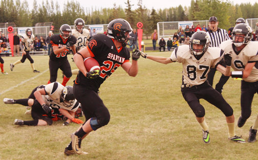 The CHS Spartans football team defeated Kindersley 21-14 in their season opener at Lions Park Sept. 12. Here, Spartans player Aaron Varjassy advances up the field.