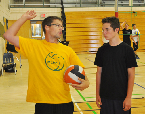 It didn't take long for the sports scene at Carpenter High School to gear up once students returned to class last week. Here, boys volleyball coach Cheyne Dallyn (left) instructs Grade 10 player Dalton Bundschuh on how to hit the ball.