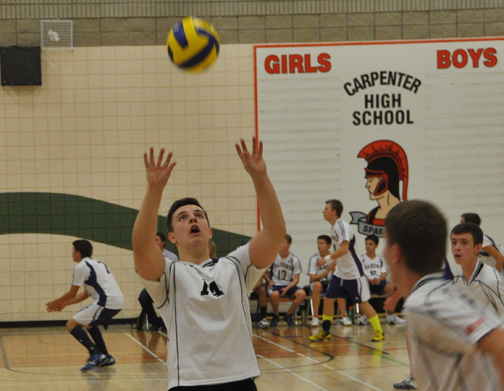 The Carpenter High School boys volleyball team hosted a tournament this past weekend, an event at which the squad ended up placing third overall. Here, Kolby Lewis sets the ball during action Friday afternoon. This tournament was Lewis' first time as a starting setter.