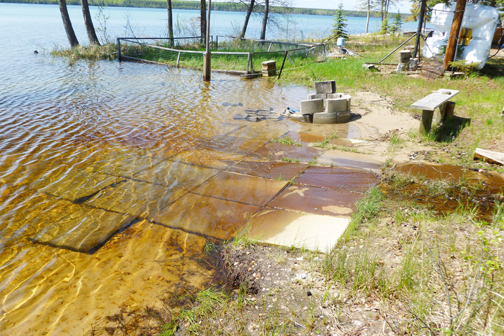 Water was already becoming too close for comfort for the fire pit and garden area located near Doug Zorn's former cabin at Jeannette Lake earlier this summer. Zorn said increasing water levels have since resulted in the area to be completely submerged.