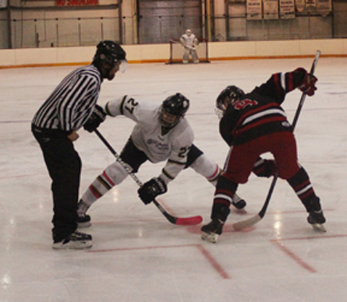 Meadow Lake Midget AA Stamps player Koby Vidal faces off against a member of the Unity Lazers during a game played at the Meadow Lake and District Arena Oct. 19. Unity went on to win this confrontation by a score of 4-2.