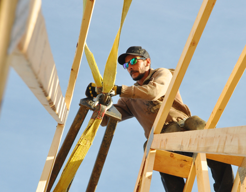 Devon Culbert of A&J Carpentry Ltd. installs roof rafters Oct. 1 at a four-unit condominium building currently under construction on Gibson Crescent. The project is one of many ongoing throughout Meadow Lake.