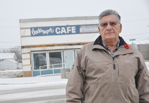 Long-time Meadow Lake resident Norman Cookman, who also serves on the Meadow Lake Thrift Mission board of directors, stands outside 301 Centre St., a close to 90-year-old building owned by the mission that, in the near future, will be demolished. The Jack's Depot Café sign was recently uncovered when siding was removed from the structure.