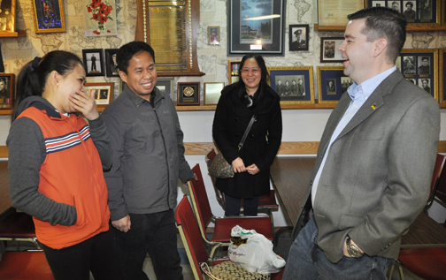 Meadow Lake MLA Jeremy Harrison (right) shares a few laughs with Mary Ann Tupil (left) and Maximo Ramos while Jennifer Madrid looks on during a special event held at Royal Canadian Legion Branch 76 in Meadow Lake Dec. 11. The event served as a way for the MLA to welcome newcomers to Saskatchewan.