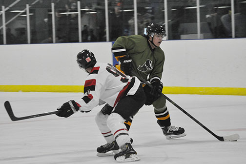 Broncos defenceman Randy Lariviere maneuvers the puck around a Birch Hills player during Game 1 action Feb. 21.
