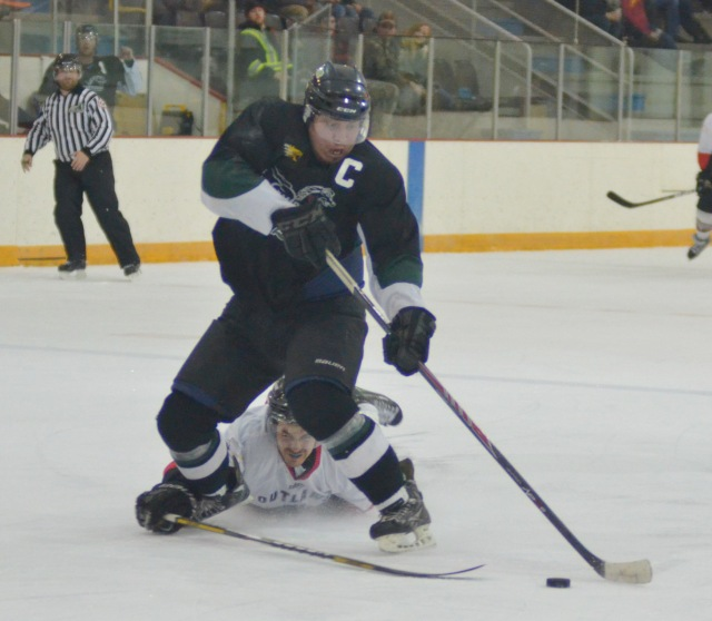 Meadow Lake Stampeder DJ King (in black) wouldn't let anything stop him, including a sprawling Waldheim player, during a breakaway attempt late in the first period of provincial hockey action Jan. 31 at the Meadow Lake and District Arena. King scored a shorthanded goal on this play, however his team lost the game 9-1.