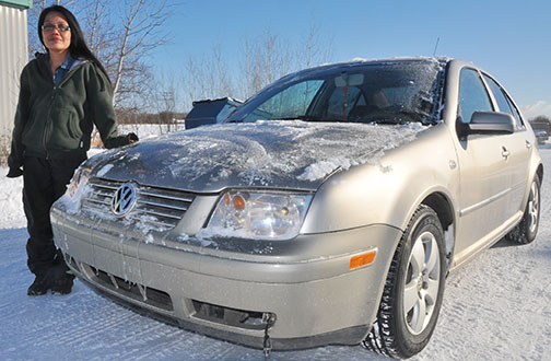Annie Santos stands with her recently recovered 2004 Volkswagen Jetta. The vehicle was stolen last month while parked at a Meadow Lake grocery store.
