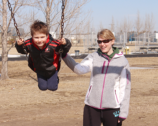 The remaining snow was melting fast last week as temperatures hit a high of 19C April 10. While Cheryl Treptow of Meadow Lake, seen here pushing her four-year-old son, Luke, on a swing April 8 in Lions Park, the temperature hovered at 12C. Environment Canada expects temperatures to remain steady this week with nighttime lows near the freezing mark.
