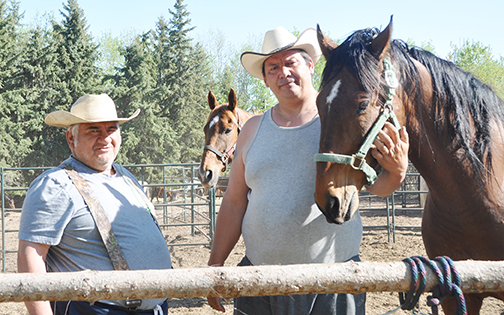 Daniel King (left) and Jason Glawson, seen here at Glawson's property north of Meadow Lake, are looking forward to an exciting season as part of the Western Chuckwagon Association.