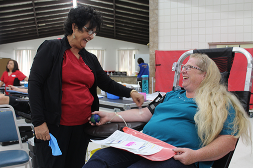 After eight years of blood donor clinics in Meadow Lake, Canadian Blood Services asked residents to roll up their sleeves for the last time May 25. Here, Meadow Lake resident Lori Allan donates blood with the assistance of phlebotomist Jacquie Matthies.