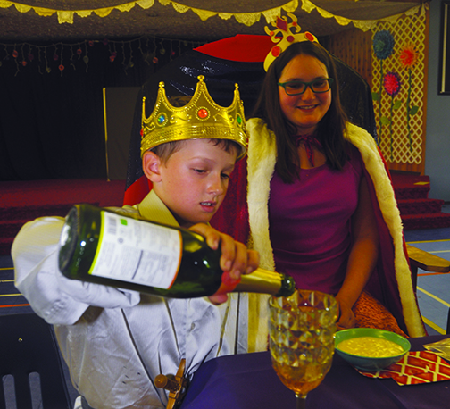 It wasn't a typical day of classes at the Meadow Lake Christian Academy June 19, as students donned their best chainmail, crowns and gowns and participated in a medieval feast. The celebration capped off the students' recent lessons in fairy tales and the Middle Ages. Here, the Queen – played by Grade 9 student Skylah Mysko – looks on as Grade 3 student Jordan Siewert, dressed as a prince, fills her glass.