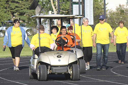 Nineteen survivors took part in this year's Relay for Life event June 20 at Lions Park in Meadow Lake. It began with registration followed by a soup and bannock meal and survivors' lap around the track. Throughout the evening, activities such as yoga and Zumba were held as others walked the track brightened with memorial luminaries. The gathering in Meadow Lake raised close to $7,000, which is less than half the amount collected in 2014. Money donated helps those battling cancer and also furthers research with the Canadian Cancer Society. Here, organizer Brenda LaRocque-Hill along with cancer survivor Flo Campbell lead the group riding a golf cart.