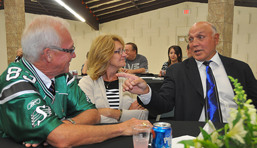 "John (left) and Roberta Patterson of Meadow Lake sit down for a face-to-face conversation with former NHL enforcer Dave ""Tiger "" Williams during the fourth annual Kinsmen Sports Dinner held June 12 at the Meadow Lake Civic Centre. For more, see Page 18."