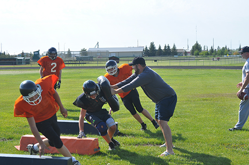The high school football season is underway in Meadow Lake. Members of the Carpenter High School Spartans began practising at Lions Park last week as they prepare for their first game of the season Sept. 3 in Warman. Here, new head coach Sam Dawson attempts to block player Ethan Prete during a footwork drill Aug. 24.