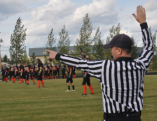 Head referee Curtis Paylor calls for the kickoff during the CHS Spartans' home opener Sept. 18 in Lions Park.