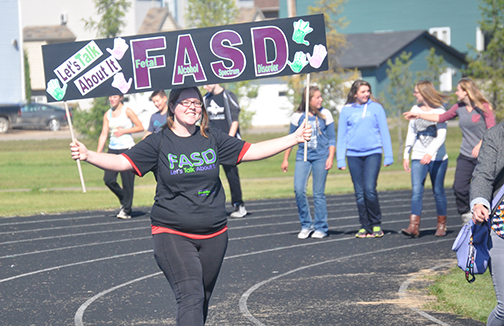 Close to 50 Meadow Lake and area residents, including students from Jonas Samson Junior High School, attended an awareness walk at Lions Park yesterday (Sept. 9) to shed light on the issue of fetal alcohol spectrum disorder (FASD). Sept. 9 also marked International FASD Awareness Day and organizers of the local event said it's important to draw more attention to the one disorder they claim is 100 per cent avoidable. Here, JSJH student Reanna Bensch leads the charge around the Lions Park track.
